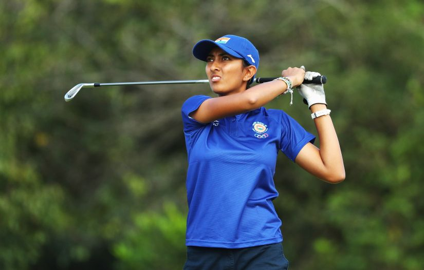 Aditi Ashok watches her tee shot on the fourth hole during the Women's Individual Stroke Play golf at the Olympics. Getty Images