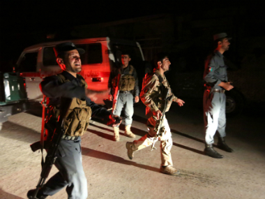 Afghan security forces rush to respond to a complex Taliban attack on the campus of the American University in Kabul on Wednesday. AP