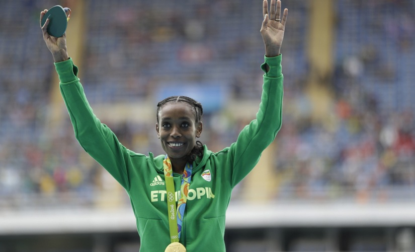Ethiopia's Almaz Ayana celebrates winning the gold in the women's 10,000-metre final. AP