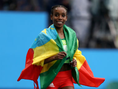 Ethiopia's Almaz Ayana celebrates after winning the women's 10,000m final. Getty Images