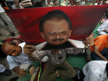 Supporters hold posters of MQM chief Altaf hussain. Reuters