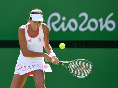 Ana Ivanovic in action against Carla Suarez in Rio. AFP