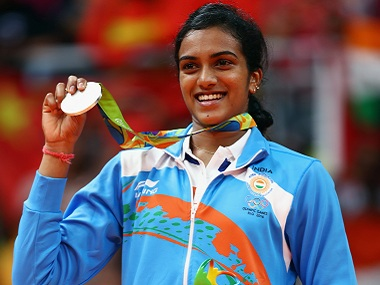 RIO DE JANEIRO, BRAZIL - AUGUST 19: Silver medalist V. Sindhu Pusarla of India celebrates during the medal ceremony after the Women's Singles Badminton competition on Day 14 of the Rio 2016 Olympic Games at Riocentro - Pavilion 4 on August 19, 2016 in Rio de Janeiro, Brazil. (Photo by Clive Brunskill/Getty Images)