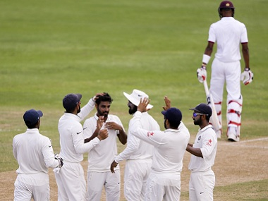 India's Bhuvneshwar Kumar congratulated by teammates after a wicket. AP