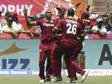Dwayne Bravo, left, celebrates after scalping the wicket of MS Dhoni to win it for West Indies. AP