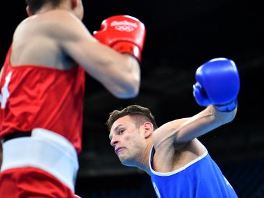 Carmine Tommassone became the first pro boxer to win an Olympic bout. AFP