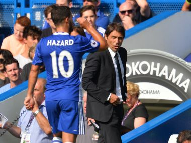File photo of Chelsea manager Antonio Conte and Eden Hazard. AFP