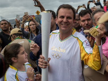 Rio de Janeiro mayor Eduardo Paes carries the Olympic torch. Getty Images