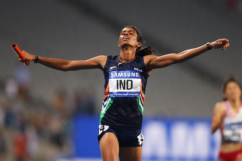 Poovamma Raju Machettira of India celebrates claiming the Gold medal in the Women's 4x400m relay final during the 2014 Asian Games at Incheon. She will take part in Rio Olympics. Getty Images