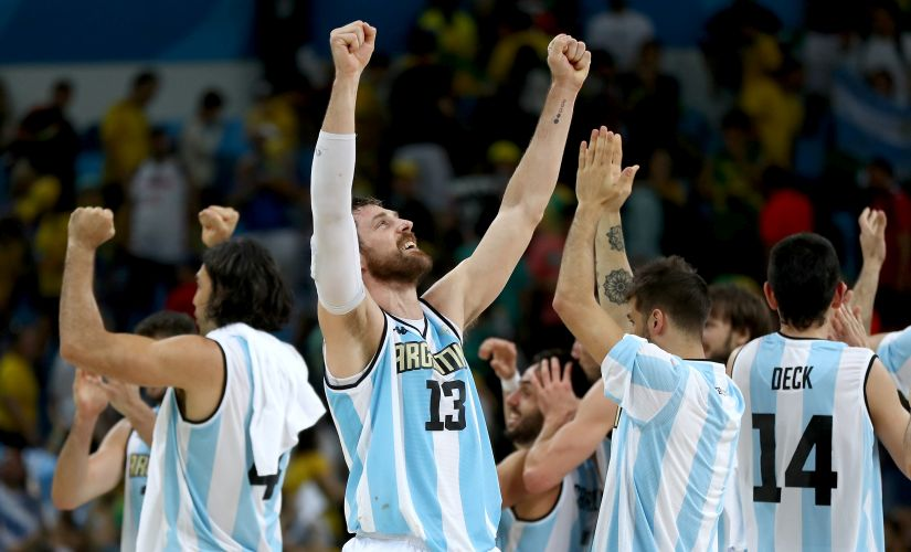 Andres Nocioni of Argentina and the rest of this teammates celebrate win over Brazil. Getty