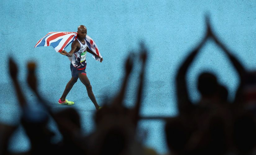 Mohamed Farah celebrates after winning the Men's 10,000m. Getty