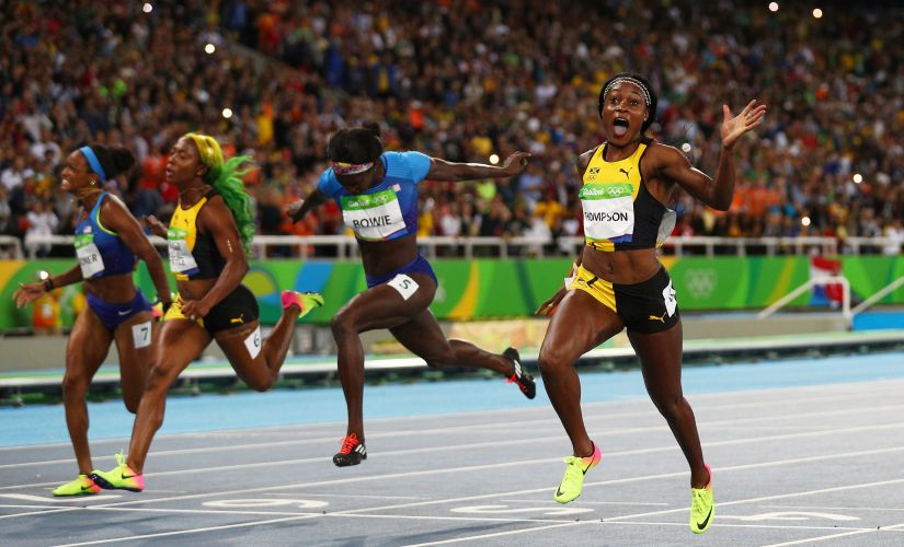 Elaine Thompson celebrates winning the Women's 100m Final. Getty