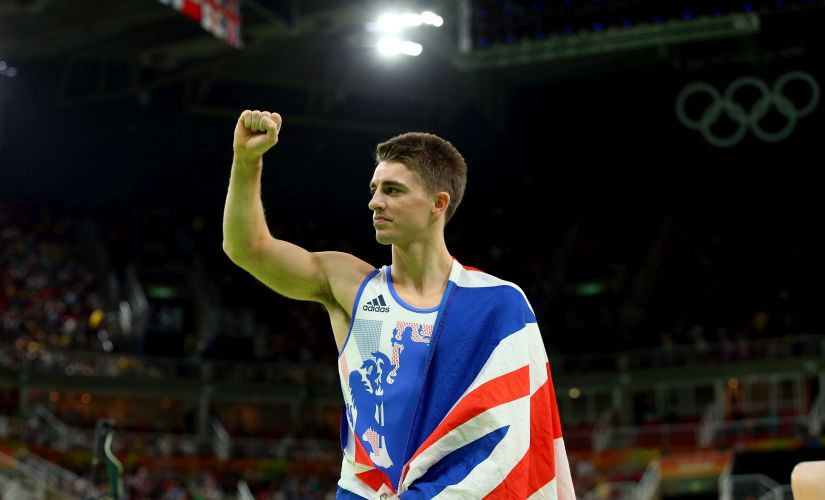 Max Whitlock celebrates winning the gold medal. Getty