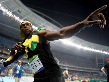 Usain Bolt celebrates winning the Men's 100 meter final. Getty