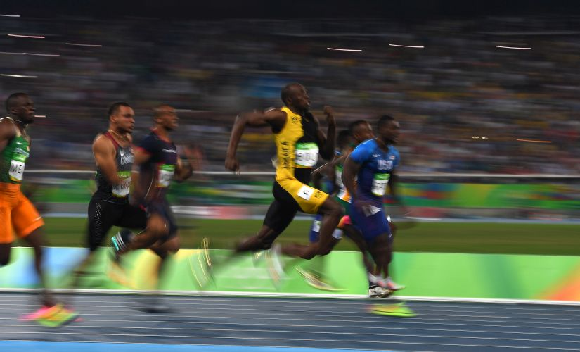 Usain Bolt runs on his way to winning the Men's 100 meter final over Justin Gatlin. Getty