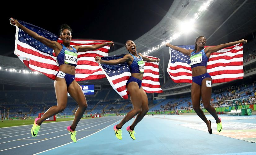 Bronze medalist Kristi Castlin, gold medalist Brianna Rollins and silver medalist Nia Ali of the United States celebrate with American flags. Getty