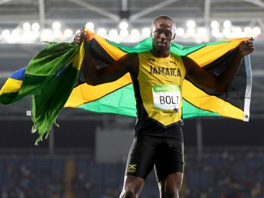 Usain Bolt celebrates winning the Men's 200m Final. Getty