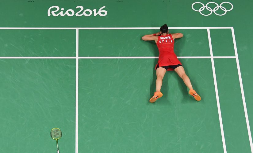 Carolina Marin celebrates match point against PV Sindhu during the Women's Singles. Getty