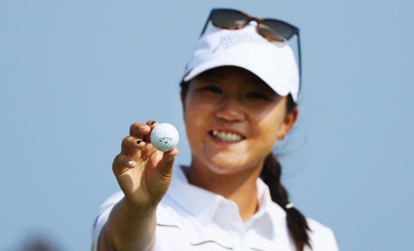 Lydia Ko poses with the golf ball. Getty