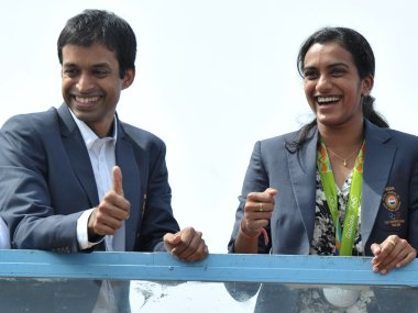 PV Sindhu and her coach P. Gopichand. AFP