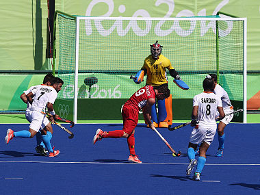 Sebastien Dockier of Belgium scores his first goal of two in their 3-1 victory over India. Getty