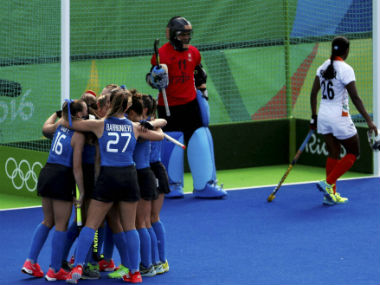 The Argentines huddle after scoring one of their five goals against India. PTI