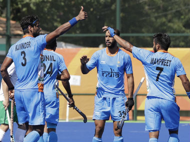 Rupinder Pal Singh (left) celebrates with his team-mates after scoring a goal against Ireland. AP