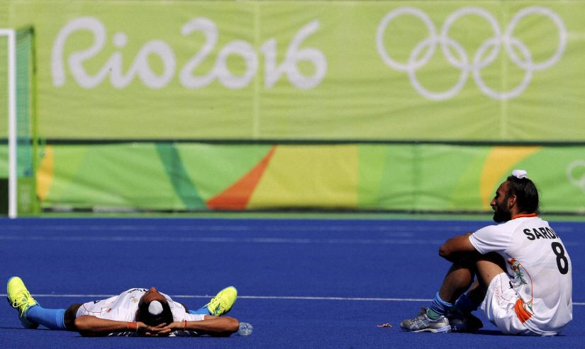 Members of the Indian hockey team after their quarterfinal loss. AP