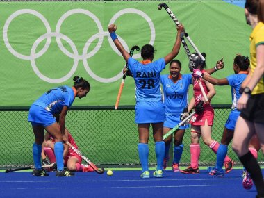 Indian women hockey players celebrate scoring against Japan during their opening match of pool B at Rio 2016. PTI