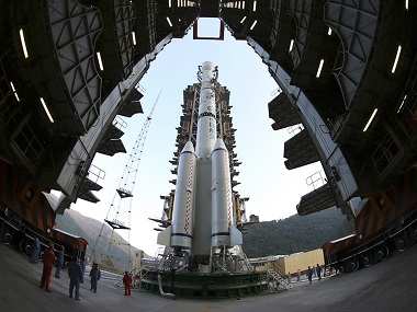 The Long March 3B rocket carrying the Chang'e-3 lunar probe is seen docked at the launch pad at the Xichang Satellite Launch Center in Liangshan on 1 December, 2013. Reuters