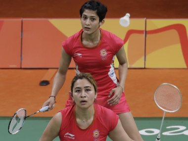 Jwala Gutta and Ashwini Ponappa in action against Thailand's Puttita Supajirakul and Sapsiree Taerattanachai. AP