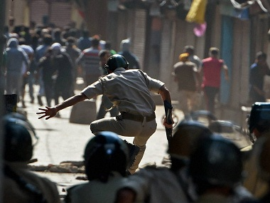 Srinagar: Police chasing away protesters throwing stones on them during a clash in Srinagar on Wednesday. PTI Photo by S Irfan (PTI8_3_2016_000312B)