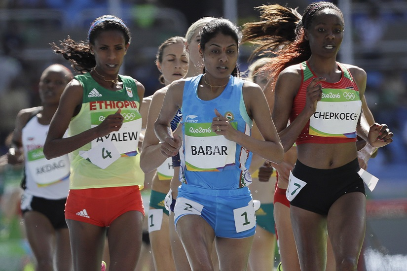 Kenya's Beatrice Chepkoech, right, and India's Lalita Babar, center, competes in a women's 3000-meter steeplechase heat during the athletics competitions of the 2016 Summer Olympics at the Olympic stadium in Rio de Janeiro, Brazil, Saturday, Aug. 13, 2016. (AP Photo/David J. Phillip)