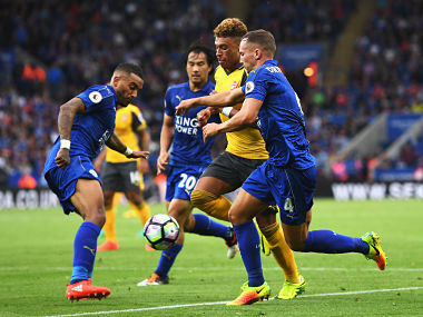 Alex Oxlade-Chamberlain of Arsenal (C) attempts to take the ball past Danny Simpson of Leicester City (L) and Daniel Drinkwater of Leicester City (R). Getty