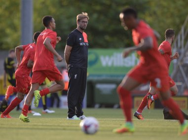 Liverpool's manager Jurgen Klopp watches his players warm up. AFP