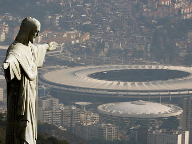 An aerial view shows the Christ the Redeemer statue with the Maracana stadium, where the opening cermony of the Rio 2016 Olympic Games will be held. Reuters