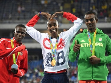 Gold medallist Britain's Mo Farah with silver medallist Kenya's Paul Kipngetich Tanui and bronze medallist Ethiopia's Tamirat Tola. AFP