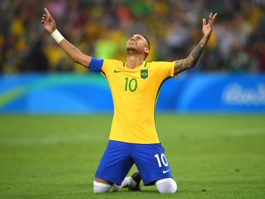 Neymar celebrates scoring the winning penalty during the Men's Football Final between Brazil and Germany. Getty