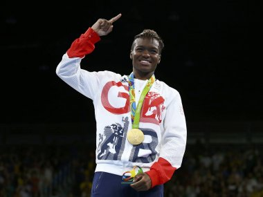 Gold medallist Nicola Adams of Britain poses with her medal. Reuters