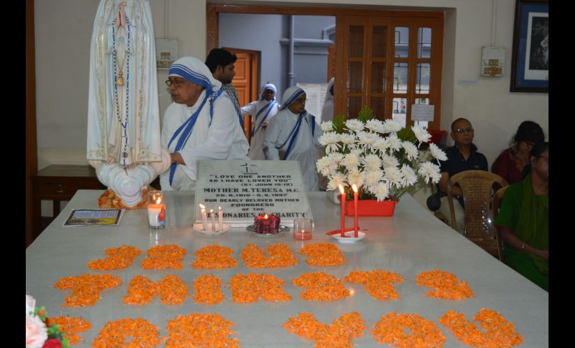Nuns pray at Mother Teresa's tomb in Kolkata. Firstpost