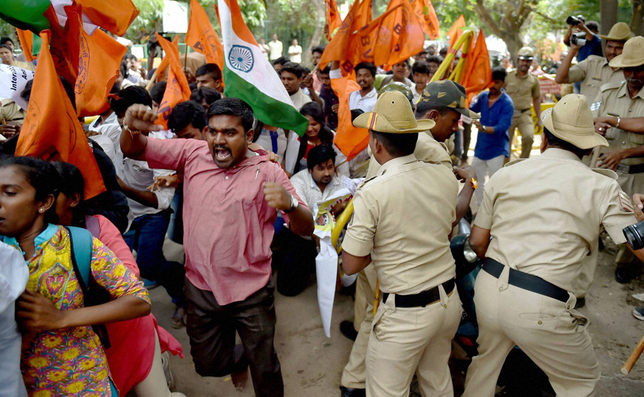 Bengaluru Police on Friday resorted to 'mild' lathi charge to disperse ABVP activists staging a protest in front of the Amnesty International India office here demanding an arrest of those who allegedly raised anti-India slogans at an Amnesty event. (Photo: PTI)