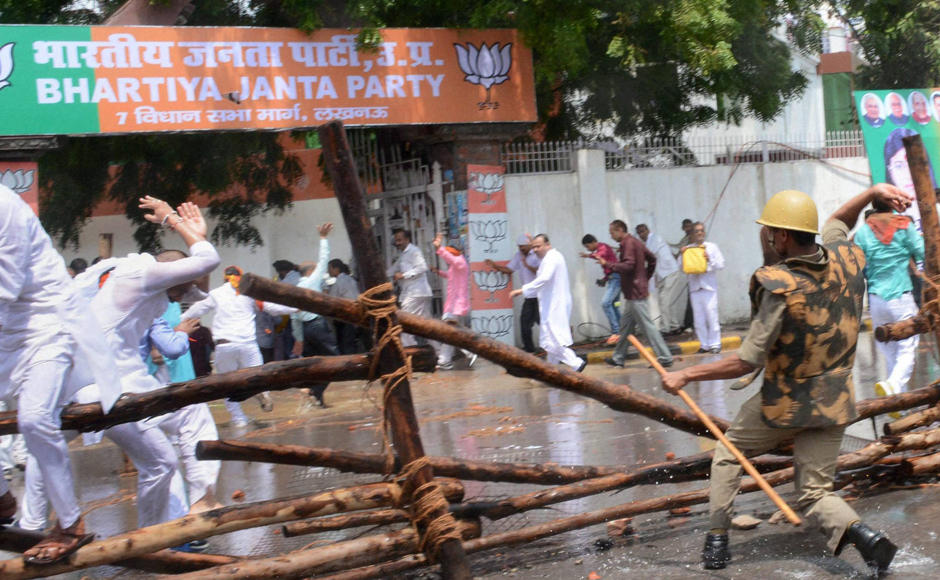 BJP workers were lathi-charged by the police as they attempted to gherao Vidhan Bhawan when the House was in process to protest against the law and order situation in the state. The police had set up huge barricades. Photo: PTI