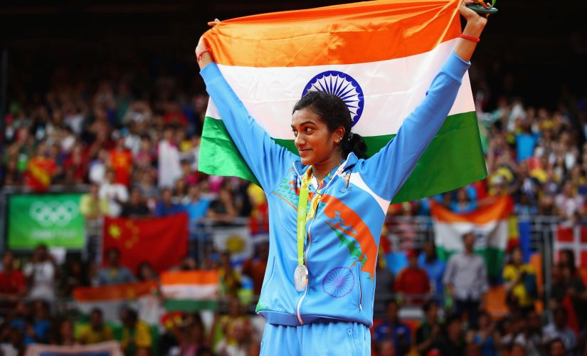 PV Sindhu stands proud with the Indian flag and her silver medal. Getty