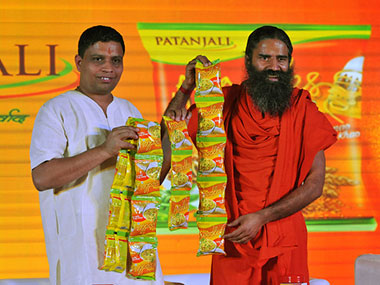 Acharaya Balkrishna, MD, Patanjali Ayurved (left) and Baba Ramdev