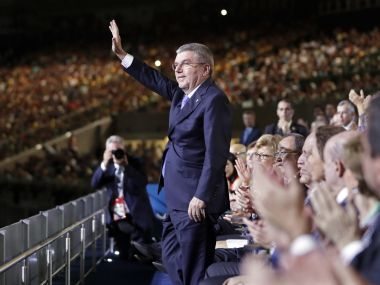 IOC President Thomas Bach waves as he is introduced during the opening ceremony. Reuters