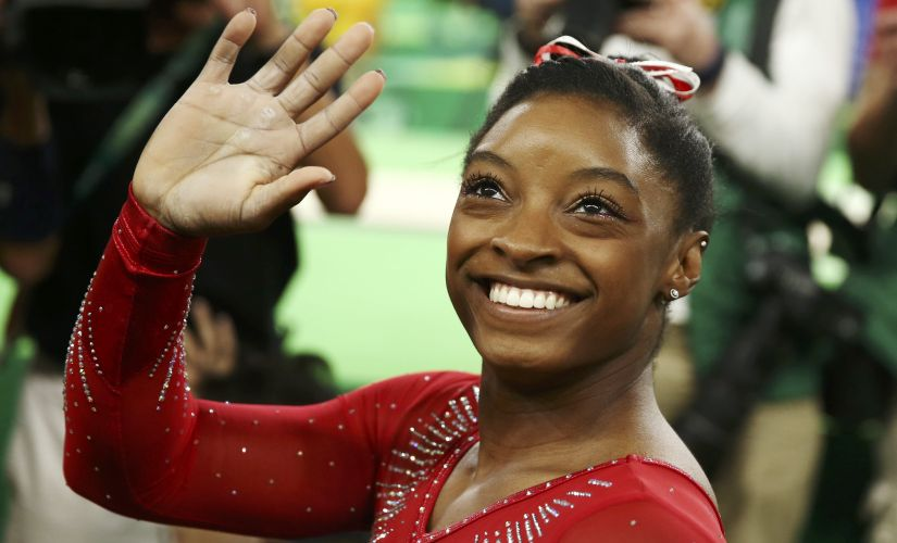 Simone Biles waves after winning the gold in the women's vault final. Reuters
