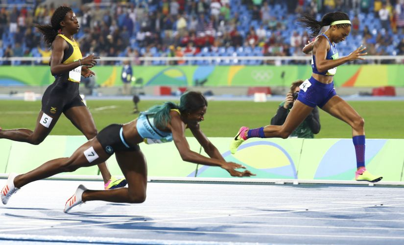Shaunae Miller dives to victory. Reuters