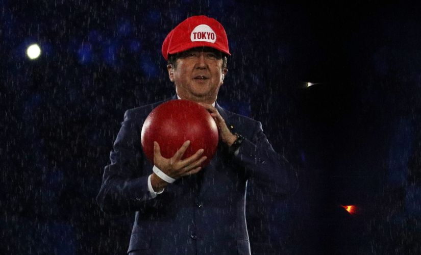 Prime Minister of Japan Shinzo Abe dressed as Super Mario on stage. Reuters
