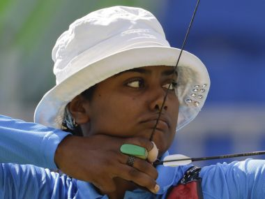 Deepika Kumari aims for the target during the women's team archery competition. AP