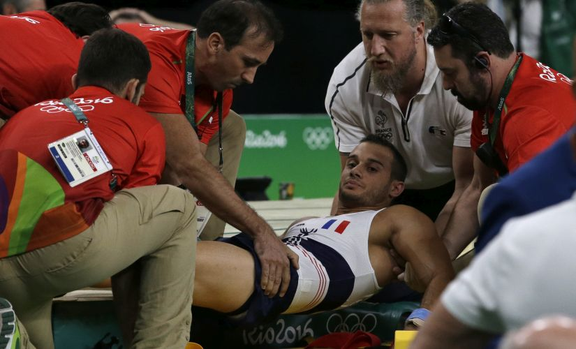 France's Samir Ait Said assisted after injuring his leg in the vault during the artistic gymnastics men's qualification. AP